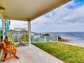 Bayfront home with shared pool, dock, playground, and more!