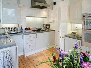Kitchen with separate utility room having American fridge freezer WM/TD