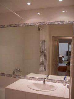Fully tiled bathroom with bath. Separate WC.