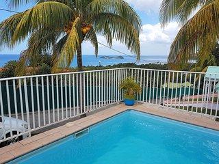 Maison de chambres vue sur mer piscine partagee