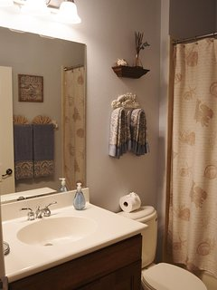 with extra towel racks and pullout shelving in the vanity!