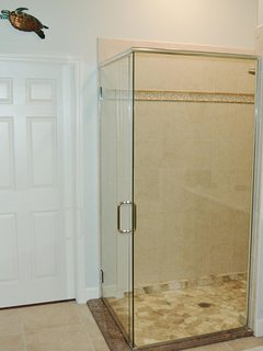 Updated shower with lots of room and shelf space