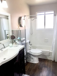 The bathroom has a combination tub/shower.