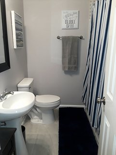 Full size bathroom off the hallway with tub/shower combination