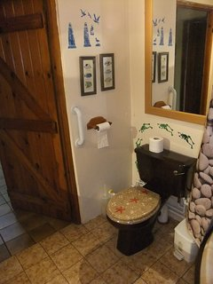 Quirky antique bathroom with huge corned bath which mum's and weary walkers adore