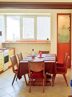 Cook a Meal in the Fully Equipped Kitchen & Dining Space.