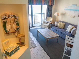 Beautiful renovated oceanfront condo with 5 heated pools, lazy river, tiki bar