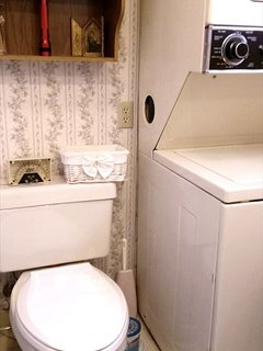 Second level bathroom with stackable washer/dryer