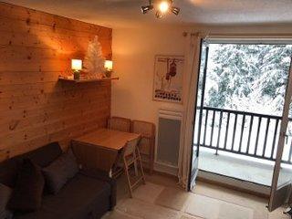 Lounge with balcony doors open.