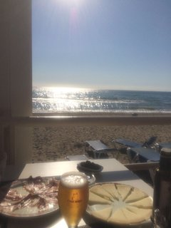 Our local 2 minute fem gate to beach facing the sea great local beer  Coffee's  Calamari