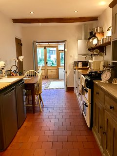 The well appointed kitchen at Bells Cottage leads into the Conservatory/dining area