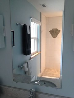 Both master suites have beautiful curb-less tiled showers