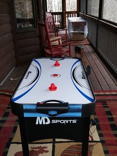 Kids will enjoy playing on the electronic air hockey game too!