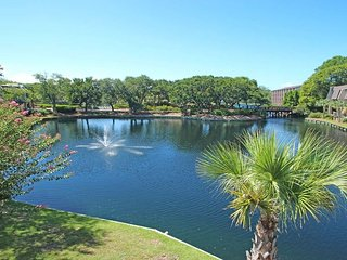 Lovely lagoon view condo, steps from the beach