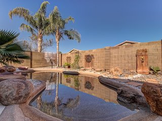 Backyard oasis with private solar heated pool, hot tub and tons of amenities!