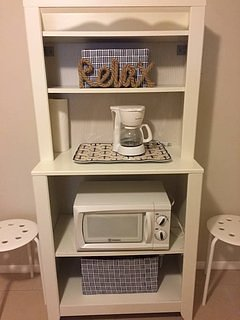 Microwave and coffee maker available in downstairs quarters for simple meals