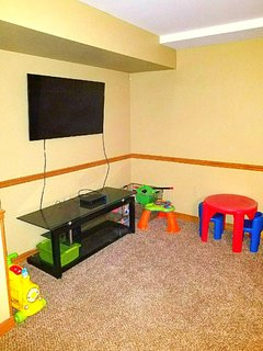 Downstairs. Use as 4th bedroom or family game area.