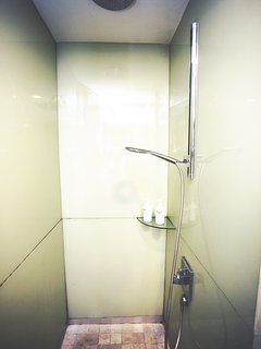 Bathroom with complimentary shampoo, shower gel and towels provided