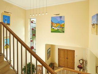 Galleried entrance hall, with specially commissioned stained glass poppy window