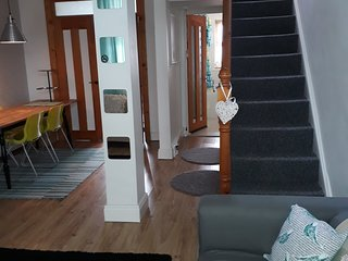 Open plan living/dining area with stairs to the 2 bedrooms