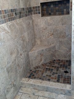 Cursor the pic and slide it. Shower stall has since been completed with fixtures, glass doors,