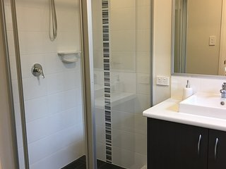 Ensuite Bathroom with shower, vanity and toilet