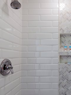 A spacious tiled shower in the Master Bath awaits you.