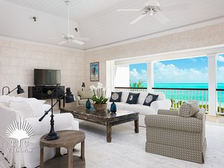 Enjoy the beautiful secluded Long Bay Beach at this Luxury 6BR Villa