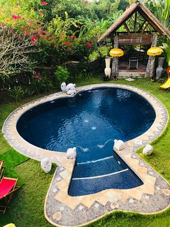 round shaped safe pool with pool house / BBQ