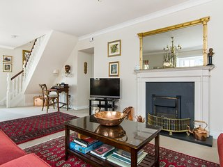 The sitting room is luxuriously appointed with traditional mahogany furniture and antiques.