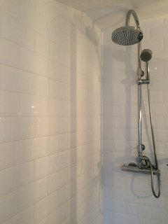 newly fitted shower with plenty of headroom over the bath