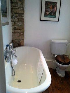Main bathroom with a claw foot slipper bath.