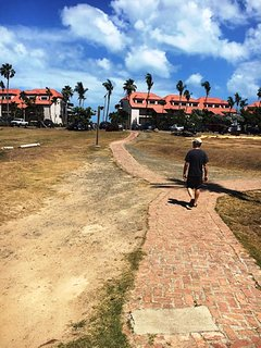 Follow the short red brick path to Sapphire Beach!