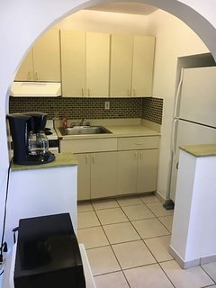Full Kitchen with stove, fridge, microwave, fully stocked.