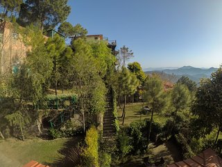 A view of all the gardens as seen from the veranda of this family holiday home in Kasauli