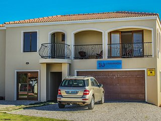 Self catering house in quiet area with sea view close to Port and Village.