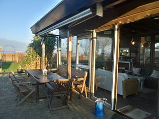 6 pers House Marijke with winter garden and direct access to the Lauwersmeer