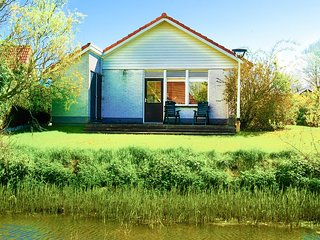 4 pers. Waterfront Chalet close to the national park Lauwersmeer