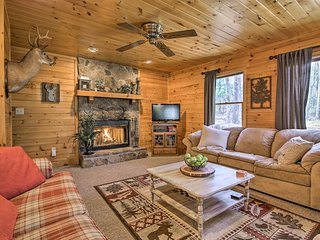 This 3-bedroom, 2-bath vacation rental cabin is named 'Freedom Finder.'