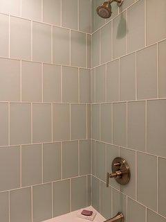 The full bath has a tiled tub/shower combo.
