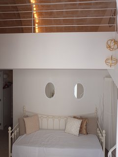 Ground floor apartment with 2 mezzanine level sleeping areas and 2 private entrances at street level