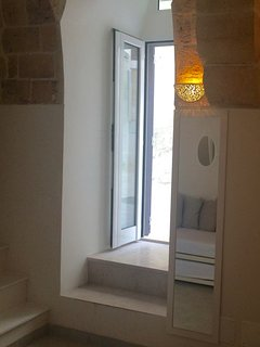 Main door to the apartment brings in the sun and opens into a courtyard
