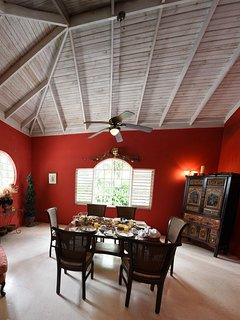 Red Dining Room with lofty ceiling.
