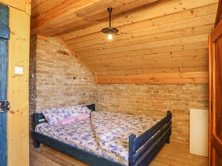 Blue room with extra large double bed and bathroom