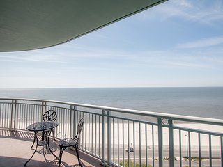 Spacious Beach View Condo w/ WiFi, Balcony, Resort Pool & Gym Access
