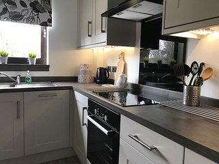 Recently refurbished and beautifully appointed apartment with parking space.