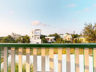 Open, lofty space with private veranda - walk into town, 150 feet to the beach!