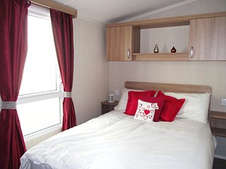 Master bedroom with dressing table, stool, mirror and 24' TV with DVD player