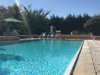 Appartamento Erika con piscina, vista mare e terrazza attrezzata con giardino