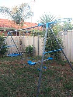 Outdoor entertaining area, umbrella & BBQ, pet & family friendly, large backyard, swing set, games